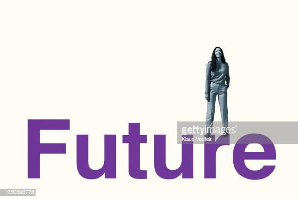portrait of smiling woman standing on future text - motivation stock pictures, royalty-free photos & images