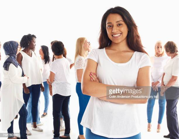Portrait of smiling woman standing out from the crowd