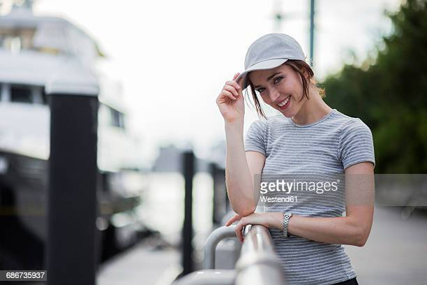 Portrait of smiling woman wearing basecap