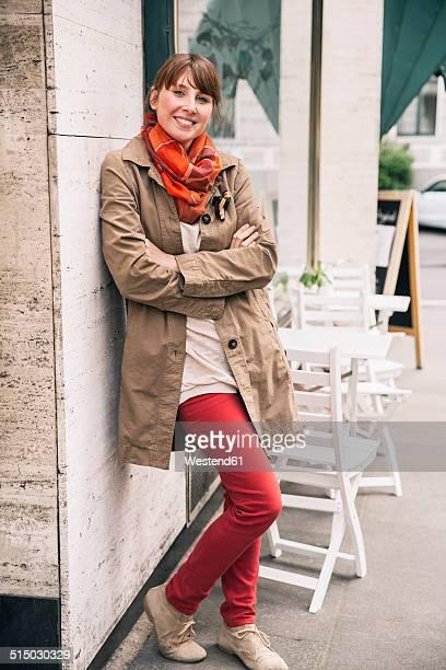 Portrait of smiling woman wearing orange scarf