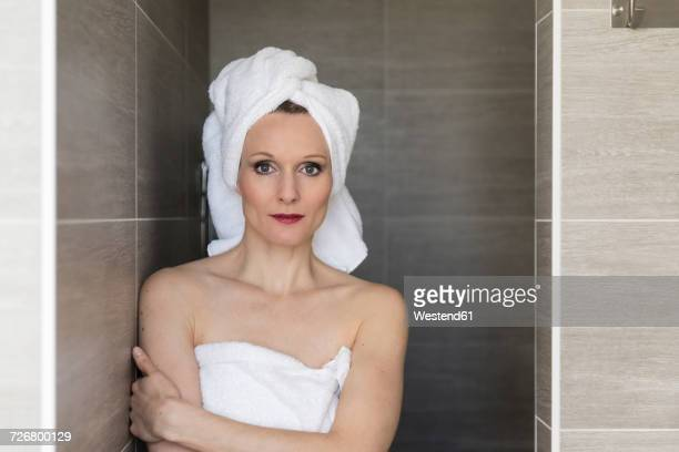 Portrait of smiling woman wearing towels in the bathroom
