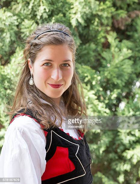 portrait of smiling woman wearing traditional hungarian costume - hungria fotografías e imágenes de stock
