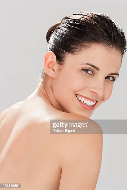 portrait of smiling woman with bare chest - chest barechested bare chested stock-fotos und bilder