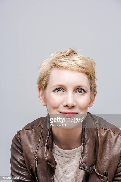 Portrait of smiling woman with blond short hair