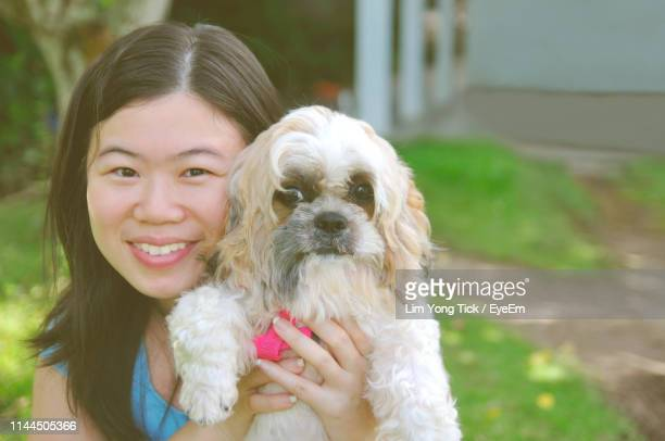 portrait of smiling woman with cute dog outdoors - dog tick stock pictures, royalty-free photos & images
