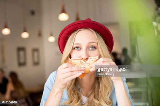 Portrait of smiling woman with food