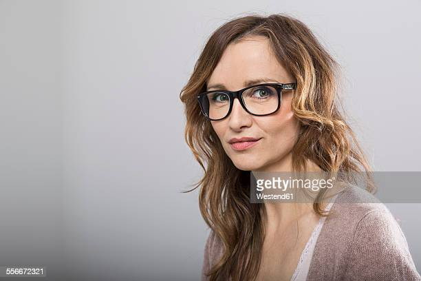 Portrait of smiling woman with glasses