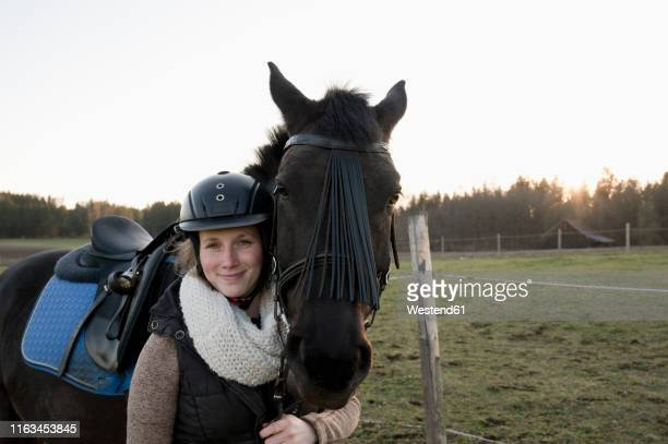 portrait of smiling woman with horse - riding hat stock pictures, royalty-free photos & images