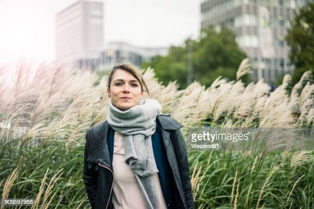 Portrait of smiling woman with scarf outdoors