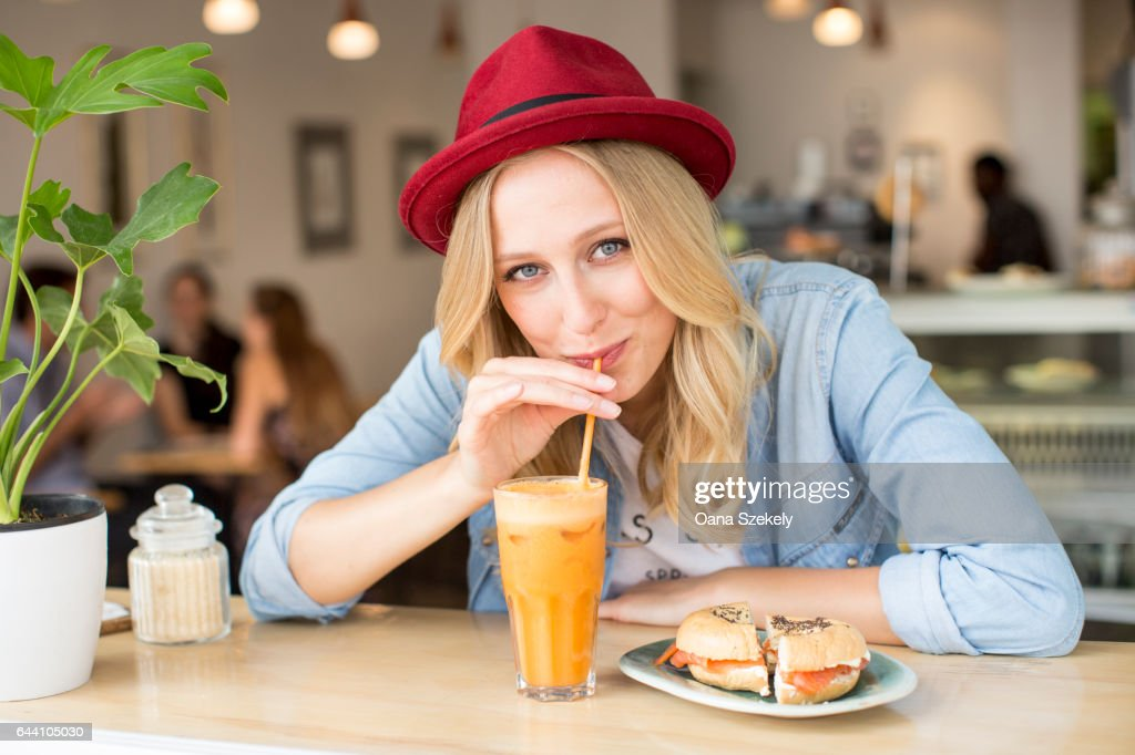 Portrait of smiling woman with smoothies : Stock Photo
