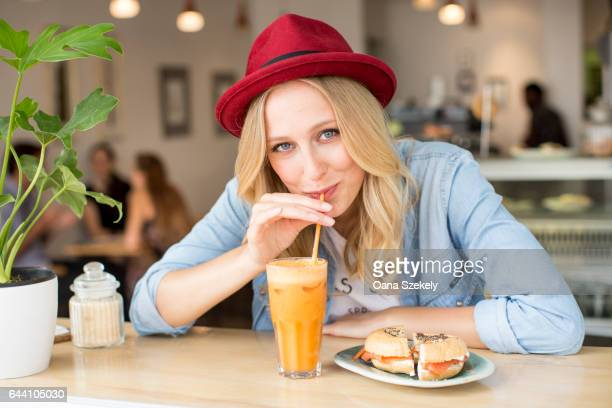 Portrait of smiling woman with smoothies
