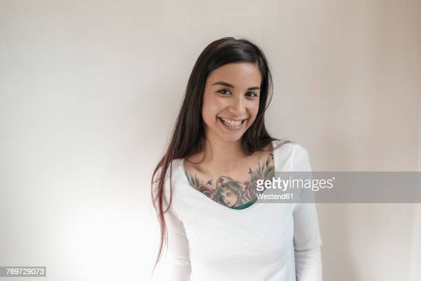 Portrait of smiling woman with tattoos