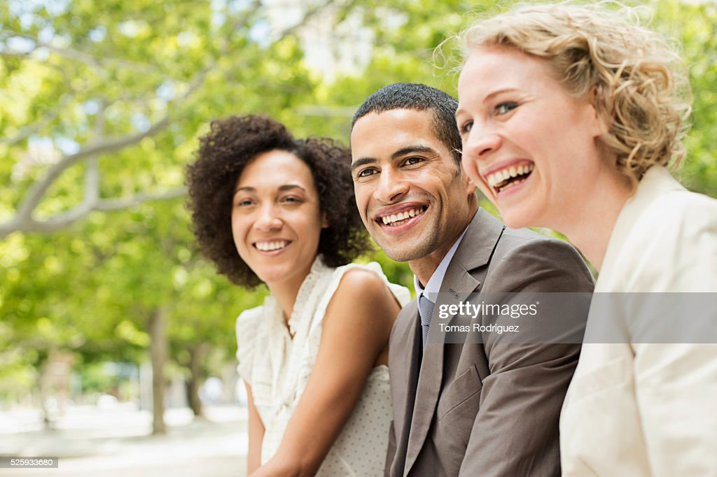 Portrait of smiling women and man : Stock Photo