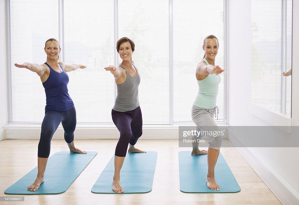 Portrait of smiling women in yoga class : Stock Photo