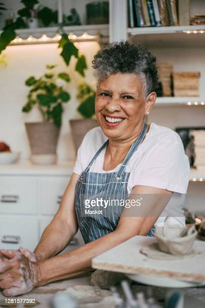 portrait of smiling wrinkled woman making ceramics in workshop - disruptaging stock pictures, royalty-free photos & images