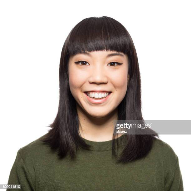 portrait of smiling young asian woman - white background stock pictures, royalty-free photos & images