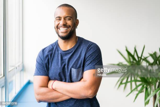 Portrait of smiling young businessman in creative office