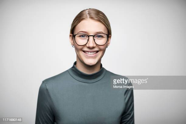 portrait of smiling young businesswoman - spectacles stock pictures, royalty-free photos & images