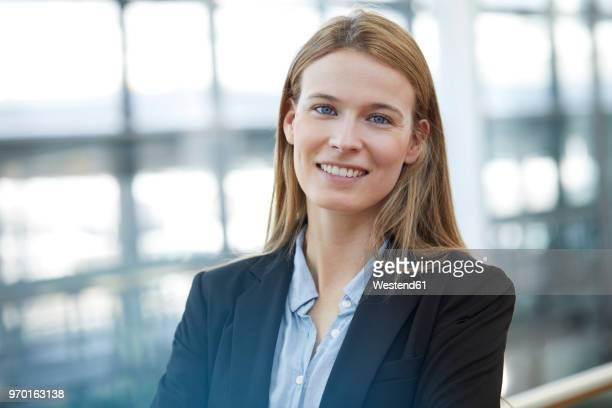 portrait of smiling young businesswoman - blazer jacket stock pictures, royalty-free photos & images
