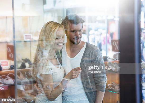 Portrait of smiling young couple on shopping tour