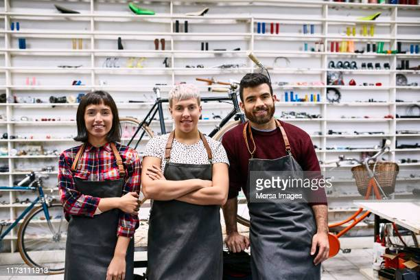 portrait of smiling young coworkers at workshop - group of objects stock pictures, royalty-free photos & images