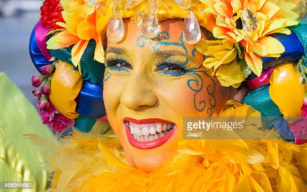 Portrait of smiling young Dutch woman wearing yellow carnival costume
