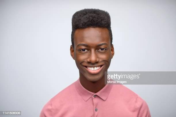 portrait of smiling young entrepreneur in studio - coiffure homme photos et images de collection