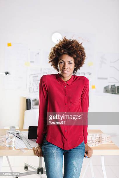 Portrait of smiling young female afro architect at her office