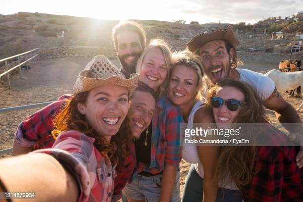 portrait of smiling young friends - medium group of people stock pictures, royalty-free photos & images