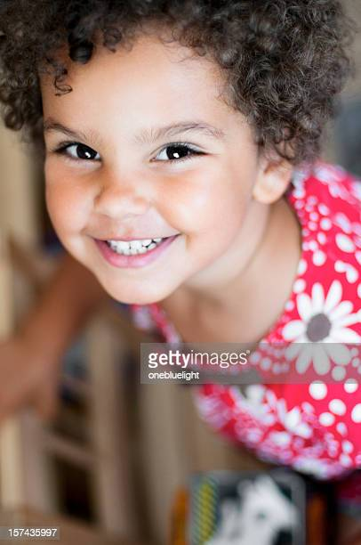 Portrait of smiling young girl in pink floral t-shirt