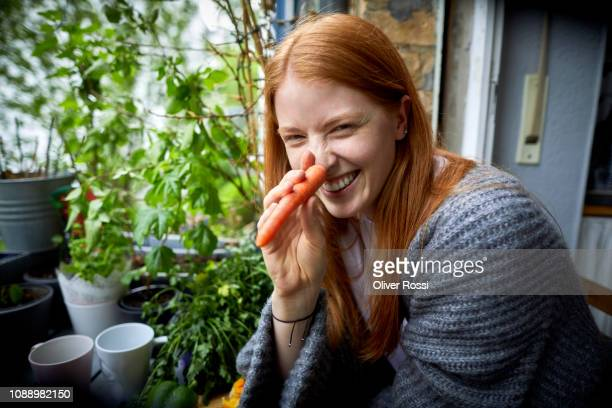 portrait of smiling young girl with carrot nose - long nose stock photos and pictures
