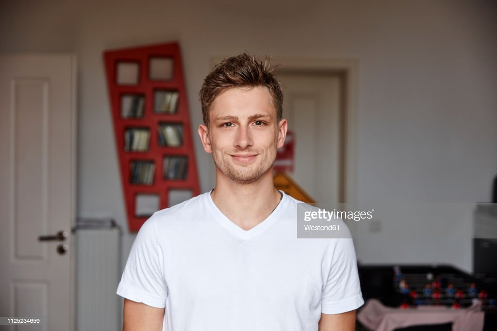 Portrait of smiling young man at home : Stock-Foto