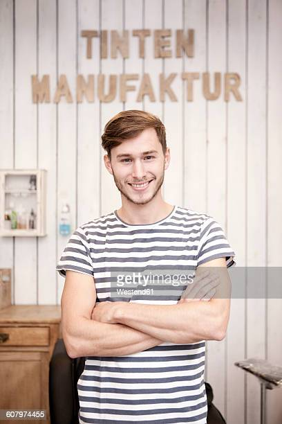 Portrait of smiling young man in a tattoo studio