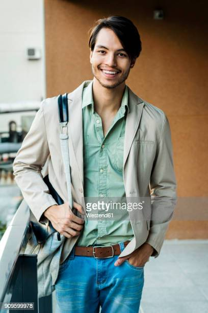 Portrait of smiling young man on balcony