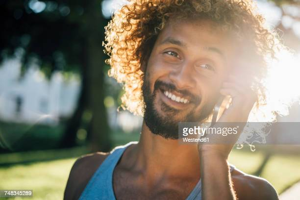 Portrait of smiling young man on cell phone