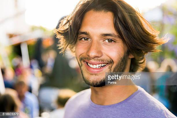 Portrait of smiling young man on vacation