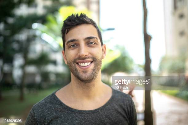portrait of smiling young man outdoors - south america stock pictures, royalty-free photos & images
