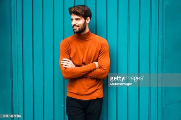 portrait of smiling young man. - distrarre lo sguardo foto e immagini stock