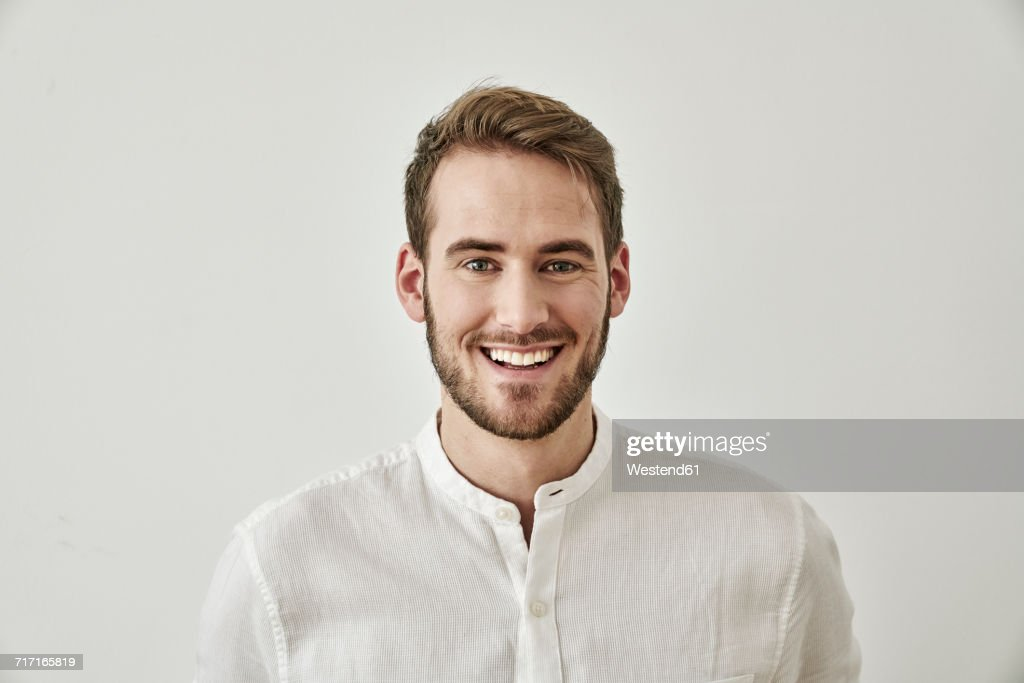 Portrait of smiling young man : Stock Photo