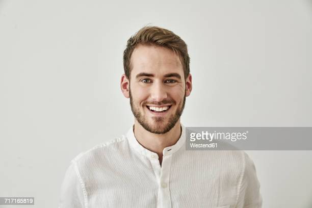 portrait of smiling young man - young men stock pictures, royalty-free photos & images