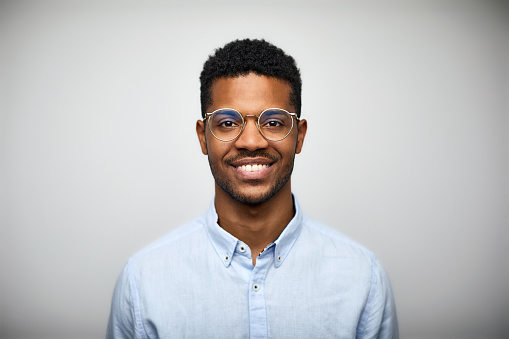 Portrait of smiling young man wearing eyeglasses - gettyimageskorea