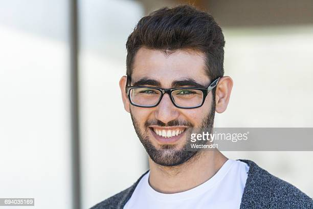 Portrait of smiling young man wearing glasses