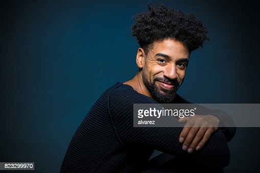 Portrait Of Smiling Young Man With Arms Crossed