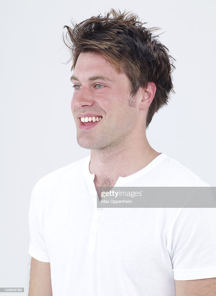 portrait of smiling young man with hairy chest : Stock Photo