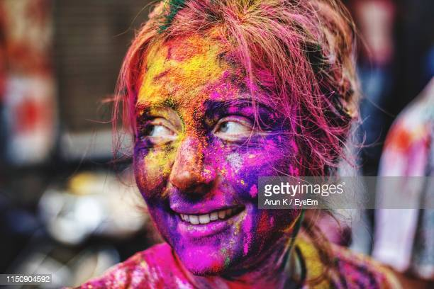 portrait of smiling young man with powder paint on face - face paint stock pictures, royalty-free photos & images