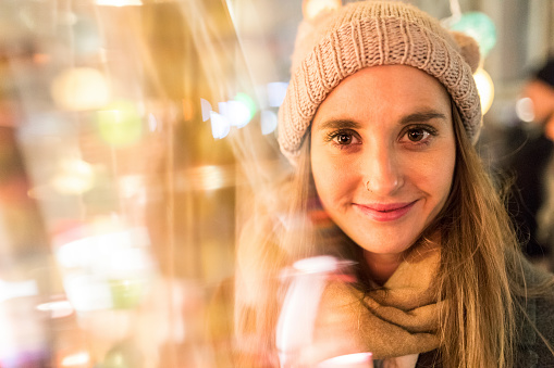 Portrait of smiling young woman at Christmas market - gettyimageskorea