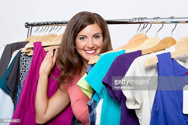 Portrait of smiling young woman at clothing store