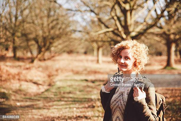 portrait of smiling young woman at richmond park - bortes cristian stock photos and pictures