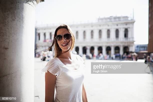 portrait of smiling young woman at st marks square - hugh sitton stock pictures, royalty-free photos & images