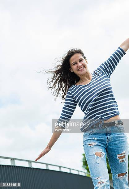 Portrait of smiling young woman balancing